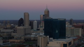 DX0001_002946 - 5.7K stock footage aerial video of a reverse view of a hotel at sunset, and then flyby skyline in Downtown Indianapolis, Indiana