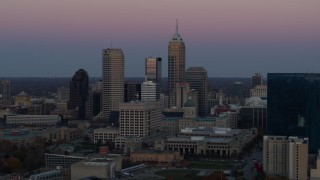 DX0001_002947 - 5.7K stock footage aerial video of a reverse view of the city's skyline at sunset in Downtown Indianapolis, Indiana