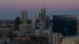 DX0001_002950 - 5.7K stock footage aerial video slowly flyby the city's skyline and a hotel at sunset in Downtown Indianapolis, Indiana