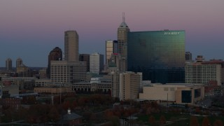 DX0001_002951 - 5.7K stock footage aerial video slowly flyby a hotel at sunset with skyline in background, Downtown Indianapolis, Indiana