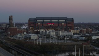 DX0001_002952 - 5.7K stock footage aerial video slowly flyby a football stadium at sunset, Downtown Indianapolis, Indiana