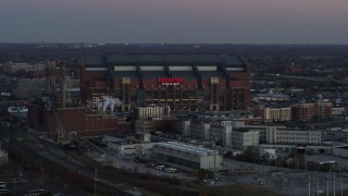 DX0001_002953 - 5.7K stock footage aerial video slowly flying away from a football stadium at sunset, Downtown Indianapolis, Indiana