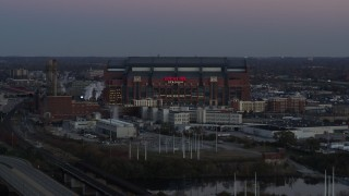 DX0001_002955 - 5.7K stock footage aerial video slow approach to a football stadium at sunset, Downtown Indianapolis, Indiana