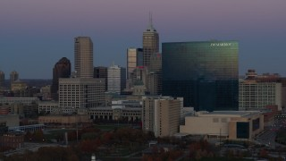 DX0001_002956 - 5.7K stock footage aerial video slow pass by hotel at twilight, Downtown Indianapolis, Indiana skyline in background