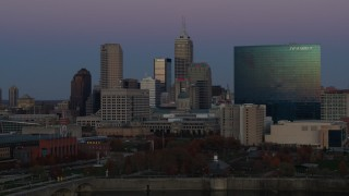 DX0001_002958 - 5.7K stock footage aerial video of slowly flying by hotel and city skyline at twilight in Downtown Indianapolis, Indiana