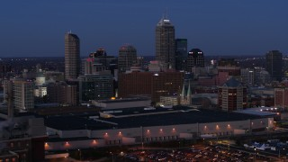 DX0001_002966 - 5.7K stock footage aerial video flyby and away from city skyline at twilight, Downtown Indianapolis, Indiana