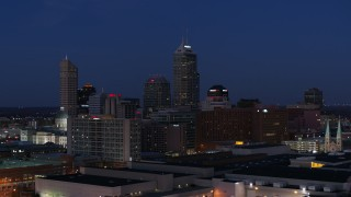 DX0001_002974 - 5.7K stock footage aerial video flyby giant skyscrapers of the city skyline at twilight, reveal smoke stacks, Downtown Indianapolis, Indiana