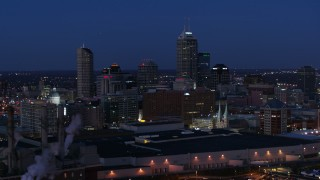 DX0001_002975 - 5.7K stock footage aerial video flyby smoke stacks and skyscrapers of the city skyline at twilight, Downtown Indianapolis, Indiana