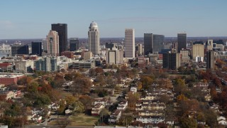 DX0001_002981 - 5.7K stock footage aerial video of slowly flying by the city's skyline, seen from apartment buildings, Downtown Louisville, Kentucky