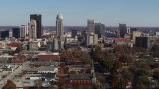 DX0001_002984 - 5.7K stock footage aerial video flying by the city's skyline, seen near churches in Downtown Louisville, Kentucky