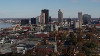 DX0001_002989 - 5.7K stock footage aerial video a reverse view of skyscrapers in the city's skyline in Downtown Louisville, Kentucky