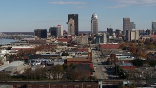 DX0001_002993 - 5.7K stock footage aerial video descend and focus on skyscrapers in the city's skyline in Downtown Louisville, Kentucky