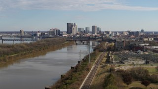 DX0001_002996 - 5.7K stock footage aerial video ascend over river with view of the city's skyline in Downtown Louisville, Kentucky