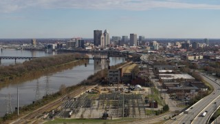 DX0001_002998 - 5.7K stock footage aerial video passing by the river with view of the city's skyline in Downtown Louisville, Kentucky