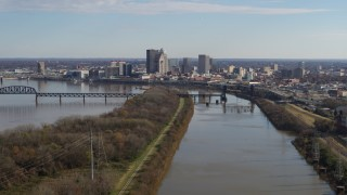 DX0001_003000 - 5.7K stock footage aerial video of the city's skyline seen while passing by the river in Downtown Louisville, Kentucky