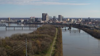 DX0001_003002 - 5.7K stock footage aerial video of a view of the city's skyline beside the river in Downtown Louisville, Kentucky