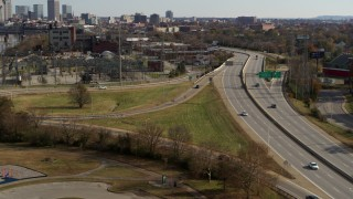 DX0001_003005 - 5.7K stock footage aerial video track cars on a freeway in Louisville, Kentucky