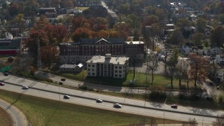 DX0001_003007 - 5.7K stock footage aerial video flyby and away from a health clinic behind historic hospital in Louisville, Kentucky