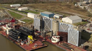 DX0001_003011 - 5.7K stock footage aerial video flyby and away from piers on the Ohio River in Louisville, Kentucky