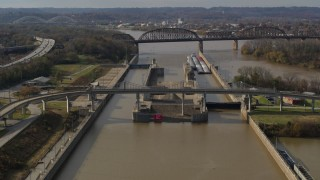 DX0001_003012 - 5.7K stock footage aerial video flying by locks and a dam on the Ohio River in Louisville, Kentucky