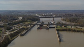 DX0001_003013 - 5.7K stock footage aerial video reverse view of locks and a dam on the Ohio River in Louisville, Kentucky