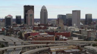 DX0001_003019 - 5.7K stock footage aerial video of city skyline seen from freeway offramp in Downtown Louisville, Kentucky