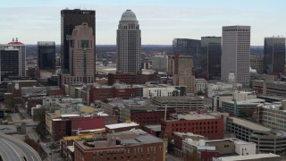 DX0001_003022 - 5.7K stock footage aerial video ascend and approach the city skyline from freeway offramp in Downtown Louisville, Kentucky