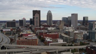 DX0001_003027 - 5.7K stock footage aerial video of a reverse view of the city's skyline seen from an offramp in Downtown Louisville, Kentucky
