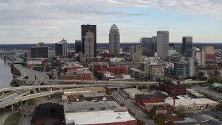 DX0001_003029 - 5.7K stock footage aerial video flyby the city's skyline beside a freeway in Downtown Louisville, Kentucky before approach