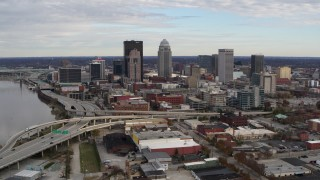 DX0001_003032 - 5.7K stock footage aerial video fly away from freeway and past city skyline in Downtown Louisville, Kentucky