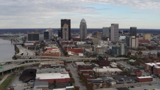 DX0001_003033 - 5.7K stock footage aerial video slowly approach tall skyscrapers in city skyline in Downtown Louisville, Kentucky