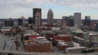 DX0001_003034 - 5.7K stock footage aerial video slow approach to tall skyscrapers in city skyline in Downtown Louisville, Kentucky