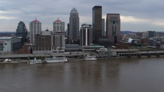 DX0001_003038 - 5.7K stock footage aerial video of hotel and skyline seen from the river in Downtown Louisville, Kentucky