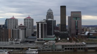 DX0001_003040 - 5.7K stock footage aerial video approach hotel and the skyline from the river in Downtown Louisville, Kentucky