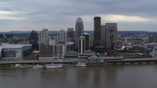 DX0001_003042 - 5.7K stock footage aerial video of flying by the city skyline beside the river in Downtown Louisville, Kentucky