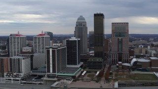 DX0001_003044 - 5.7K stock footage aerial video reverse view of riverfront hotel and the city skyline, reveal the river in Downtown Louisville, Kentucky