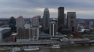 DX0001_003050 - 5.7K stock footage aerial video reverse view of skyline and hotel, revealing the Ohio River in Downtown Louisville, Kentucky