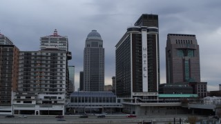 DX0001_003059 - 5.7K stock footage aerial video passing hotel with skyscrapers in background, Downtown Louisville, Kentucky