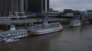 DX0001_003060 - 5.7K stock footage aerial video of historic riverboat docked by Downtown Louisville, Kentucky