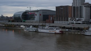 DX0001_003062 - 5.7K stock footage aerial video reverse view of historic riverboat docked by Downtown Louisville, Kentucky