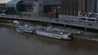 DX0001_003063 - 5.7K stock footage aerial video approach the historic riverboat docked by Downtown Louisville, Kentucky