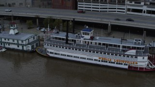 DX0001_003064 - 5.7K stock footage aerial video close-up view of the historic riverboat docked by Downtown Louisville, Kentucky