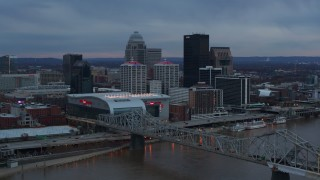 DX0001_003085 - 5.7K stock footage aerial video of the arena and city skyline at sunset, seen from near the bridge, Downtown Louisville, Kentucky