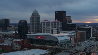 DX0001_003086 - 5.7K stock footage aerial video flyby arena and city skyline at sunset, seen while passing bridge, Downtown Louisville, Kentucky