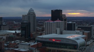 DX0001_003087 - 5.7K stock footage aerial video fly away from the arena and city skyline at sunset, Downtown Louisville, Kentucky