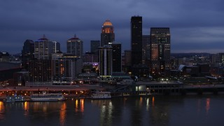 DX0001_003097 - 5.7K stock footage aerial video of flying by the skyline at twilight, seen from Ohio River, Downtown Louisville, Kentucky
