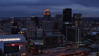 DX0001_003099 - 5.7K stock footage aerial video of approaching the skyline lit up at twilight, Downtown Louisville, Kentucky