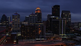 DX0001_003105 - 5.7K stock footage aerial video fly over Ohio River toward the hotel and skyline lit up at twilight, Downtown Louisville, Kentucky