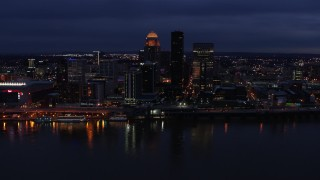 DX0001_003109 - 5.7K stock footage aerial video slowly pass the city's skyline at twilight, seen from across Ohio River, Downtown Louisville, Kentucky