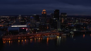 DX0001_003111 - 5.7K stock footage aerial video slowly fly away from and by the city's skyline at twilight, seen from Ohio River, Downtown Louisville, Kentucky